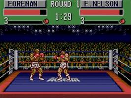 In game image of George Foreman's KO Boxing on the Sega Master System.