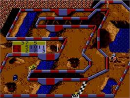 In game image of Ironman Ivan Stewart's Super Off-Road on the Sega Master System.