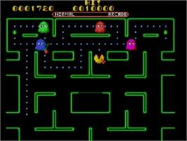 In game image of Ms. Pac-Man on the Sega Master System.