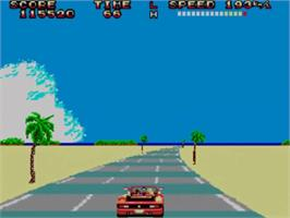 In game image of Out Run on the Sega Master System.