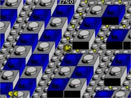 In game image of Pac-Mania on the Sega Master System.