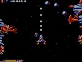 In game image of Xenon 2: Megablast on the Sega Master System.