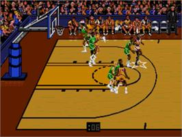 In game image of Bulls vs. Lakers and the NBA Playoffs on the Sega Nomad.