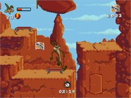 In game image of Desert Demolition Starring Road Runner and  Wile E. Coyote on the Sega Nomad.