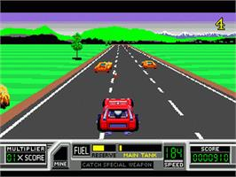 In game image of Road Blasters on the Sega Nomad.