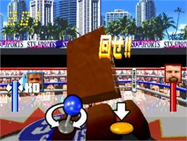 In game image of Funky Head Boxers on the Sega ST-V.