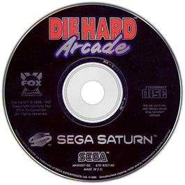 Artwork on the Disc for Die Hard Arcade on the Sega Saturn.