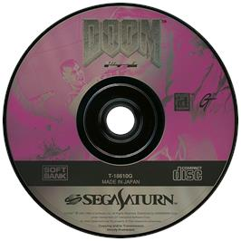 Artwork on the Disc for Doom on the Sega Saturn.