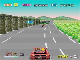 In game image of Out Run on the Sega Saturn.