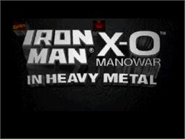 Title screen of Iron Man / X-O Manowar in Heavy Metal on the Sega Saturn.
