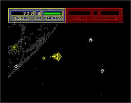In game image of Blasteroids on the Sinclair ZX Spectrum.