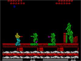 In game image of Forgotten Worlds on the Sinclair ZX Spectrum.