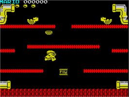 In game image of Mario Bros. on the Sinclair ZX Spectrum.