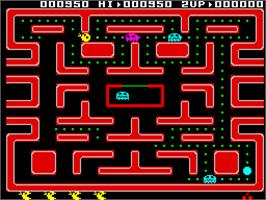 In game image of Ms. Pac-Man on the Sinclair ZX Spectrum.