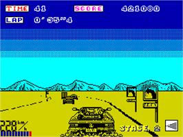 In game image of OutRun on the Sinclair ZX Spectrum.