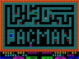In game image of Pac-Man on the Sinclair ZX Spectrum.