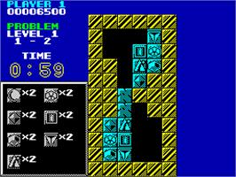 In game image of Puzznic on the Sinclair ZX Spectrum.