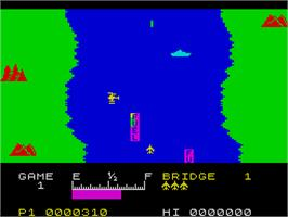 In game image of River Raid on the Sinclair ZX Spectrum.
