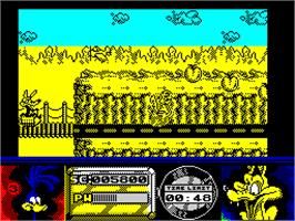 In game image of Road Runner and Wile E. Coyote on the Sinclair ZX Spectrum.