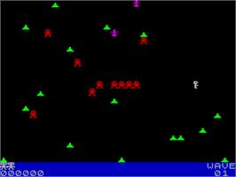 In game image of Robotron: 2084 on the Sinclair ZX Spectrum.