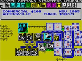 In game image of SimCity on the Sinclair ZX Spectrum.