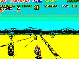 In game image of Super Hang-On on the Sinclair ZX Spectrum.
