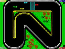 In game image of Super Sprint on the Sinclair ZX Spectrum.