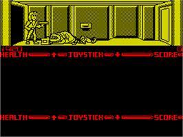 In game image of Xenophobe on the Sinclair ZX Spectrum.