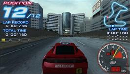 In game image of Ridge Racer on the Sony PSP.