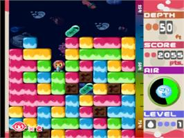 In game image of Mr. Driller on the Sony Playstation.