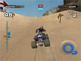In game image of ATV: Quad Power Racing 2 on the Sony Playstation 2.