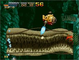 In game image of Metal Slug - Super Vehicle-001 on the Sony Playstation 2.