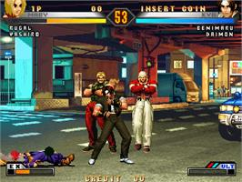 In game image of King of Fighters 98 Ultimate Match on the Taito Type X.