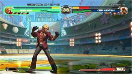 In game image of King of Fighters XII, The on the Taito Type X2.