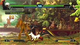 In game image of King of Fighters XIII, The on the Taito Type X2.