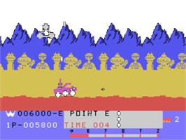 In game image of Moon Patrol on the Texas Instruments TI 99/4A.